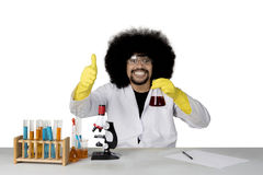 Afro scientist showing thumb up on studio. Image of an Afro male scientist doing chemical research while showing thumb up at the camera, isolated on white Royalty Free Stock Photography