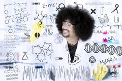 Afro scientist writing research formulas. Close up of Afro scientist writing research formulas on whiteboard in the laboratory Royalty Free Stock Image