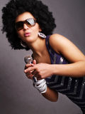 Afro singer holding microphone Stock Images