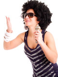 Afro singer holding microphone Stock Image