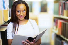 Afro student reading Royalty Free Stock Photos