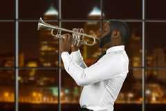 Afro trumpeter playing music. royalty free stock photos