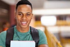Afro- universitetsstudent royaltyfri bild