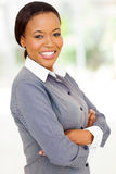 Afro woman arms folded. Attractive afro american woman with arms folded looking at the camera Stock Photo
