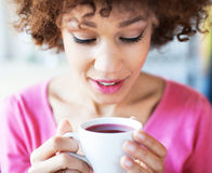 Afro woman with cup of tea Stock Images
