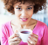 Afro woman with cup of tea Stock Photo