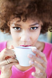 Afro woman with cup of tea Royalty Free Stock Images