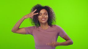 Free Afro Woman Dances And Has Fun, Feels Amused And Upbeat, Performs Victory Dance Royalty Free Stock Images - 156593469