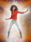 Afro Woman Dancing With Lighting Effect Stock Photography