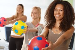 Afro woman exercising with ball Stock Photography