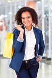 Afro woman holding shopping bags Stock Photography