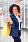 Afro woman holding shopping bags Royalty Free Stock Photos