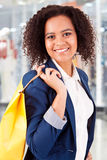 Afro woman holding shopping bags Royalty Free Stock Photo