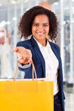 Afro woman holding shopping bags Stock Photo