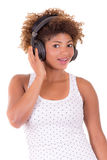 Afro woman listening music. Stock Photography