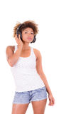 Afro woman listening music. Stock Images