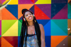 Free Afro Woman Listing To Music On Colorful Background Stock Photo - 70409810