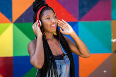 Free Afro Woman Listing To Music On Colorful Background Stock Photos - 70410443