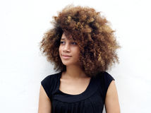 Afro woman looking away. Closeup portrait of a afro black woman with curly hair looking away standing against white background Stock Image