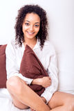 Afro woman relaxing in bed Royalty Free Stock Photo