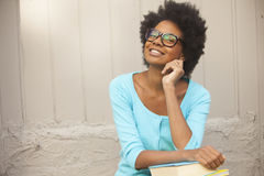 Afro woman smiling with books Royalty Free Stock Images