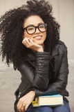 Afro woman smiling with books. Afro woman smiling wearing glasses with books Stock Photo