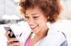 Afro woman using mobile phone Royalty Free Stock Images