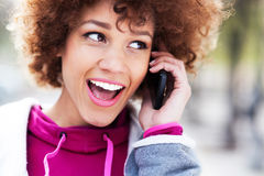 Afro woman using mobile phone Royalty Free Stock Photography