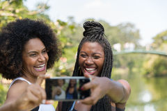 Afro women taking selfie photos in the park Stock Photography