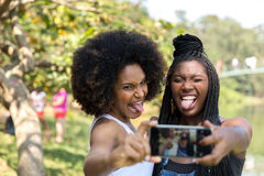 Afro women taking selfie photos in the park Royalty Free Stock Photo