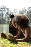 Afro women using tablet computer in the park Stock Photos