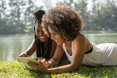 Afro women using tablet computer in the park Stock Photo