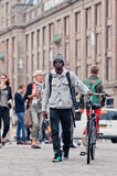 Afro young man on the Dam Square, Amsterdam, Netherlands Royalty Free Stock Photo