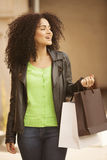 Afro young woman with bags Stock Photo
