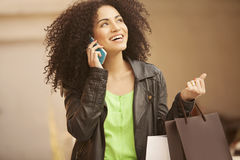 Afro young woman with bags Stock Photography