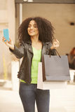 Afro young woman with bags Royalty Free Stock Photos