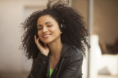 Afro young woman with headphones Stock Photos