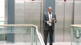 AfroAmerican businessman on phone in a building Royalty Free Stock Images