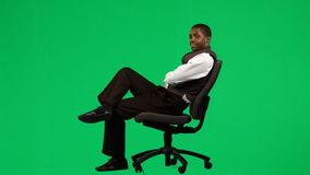 AfroAmerican businessman relaxing on a chair footage Stock Image