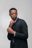 Afroamerican facet w drogim galanteryjnym czarnym kostiumu Obrazy Stock