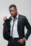 Afroamerican facet w drogim galanteryjnym czarnym kostiumu Zdjęcie Royalty Free