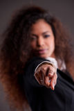 Afroamerican girl pointing out her finger to you Royalty Free Stock Images