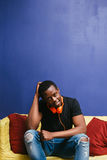 Afroamerican guy with headphones, home leisure Stock Images