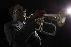 Afroamerican Jazz Musician with Flugelhorn Royalty Free Stock Image