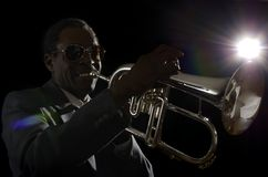 Afroamerican Jazz Musician with Flugelhorn. Studio Shot Royalty Free Stock Image