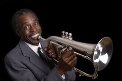 Afroamerican Jazz Musician with Flugelhorn smiling Royalty Free Stock Images