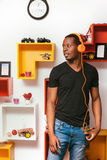 Afroamerican man in headphones at home, leisure Royalty Free Stock Photos