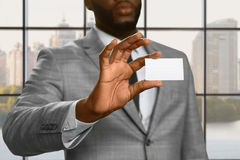Afroamerican office employee showing ID. Royalty Free Stock Image
