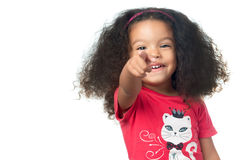 Afroamerican small girl pointing to the camera and laughing. Isolated on white royalty free stock images