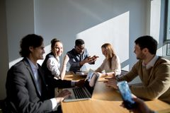 Business people listening to marketing professional african speaker presentation Stock Image